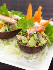 spicy salad with avocado and seafood