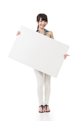 Attractive young asian woman holding blank board