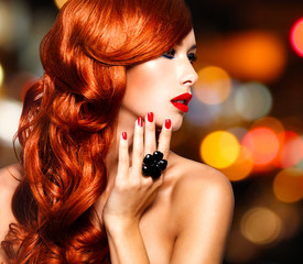 Wall Mural - Beautiful sensual woman with long red hairs.