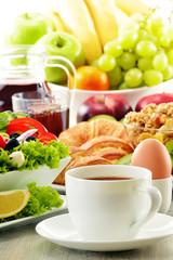 Breakfast with coffee, juice, croissant, salad, musli and egg