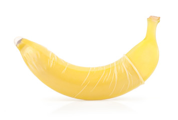 Yellow Banana with Condom Isolated on White Background