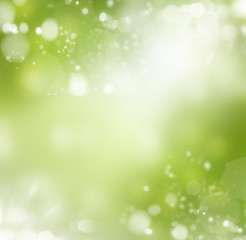 Spring or summer abstract background with bokeh lights.
