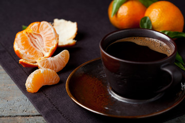 Cup of coffie and clementines