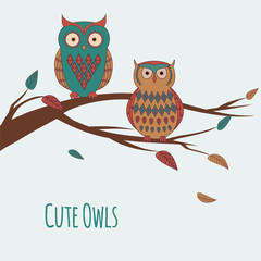 Vector illustration of two cute colorful owls sitting on a branc