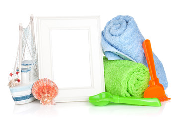 Photo frame with beach towels and toys