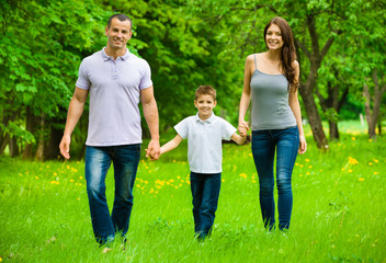 Wall Mural - Full-length portrait of happy family of three