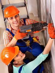 Wall Mural - Family in builder uniform indoor.
