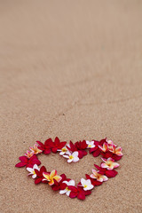 Flower love symbol on sand