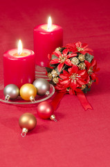 Christmas decoration with candles ribbons and cookies
