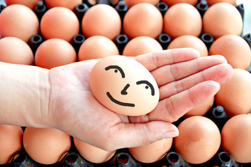 Egg on hands and smile face.