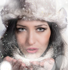 Wall Mural - Portrait of attractive young woman in winter