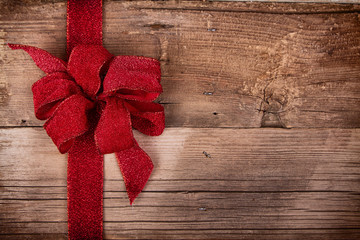 Christmas ribbon on wooden background