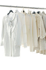 Row of female coat on hangers at the show