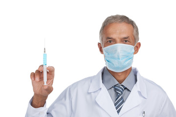 Experienced doctor is doing vaccination.