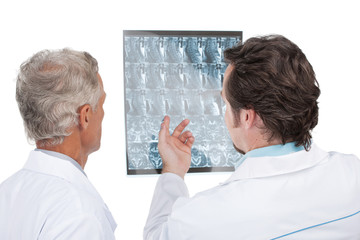 Close up of two doctors discussing diagnose of the patient.