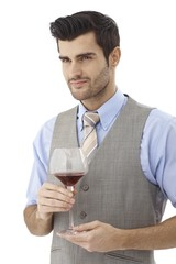 Portrait of young man with glass of wine