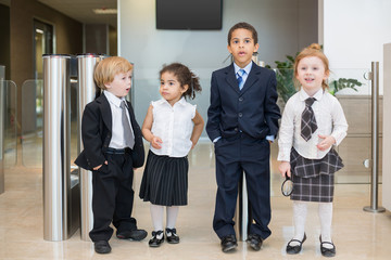 Four children with surprised faces in Business center
