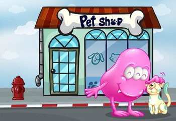 A pink beanie monster and a pet in front of the pet shop