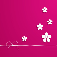 pink background with flowers and a border