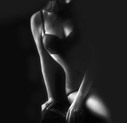 Perfect woman body on black background