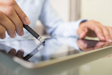 Man working with stylus and digital tablet pc