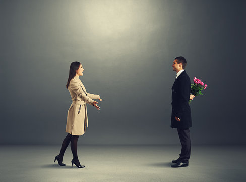 man with flowers waiting his woman