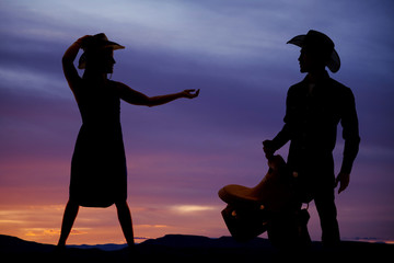 silhouette woman cowgirl hand out