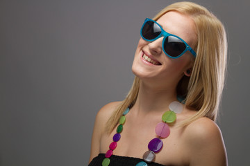 Close up Portrait of Young Blond Female Smiling in Sunglasses