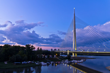 Cable bridge at twilight over Sava river near Ada island