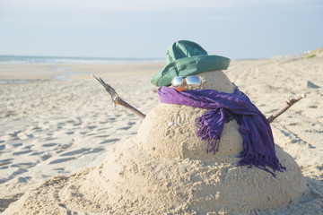Fototapete - Snowman Made Out Of Sand With Hat