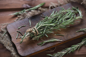 Close-up of rosemary on a rustic cutting board, studio shot