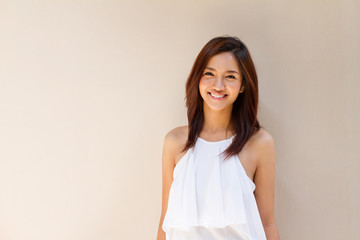 happy smiling woman in casual dress, plain background