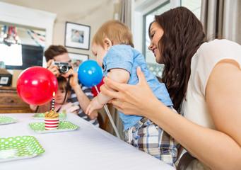 Family Celebrating Son's Birthday At Home