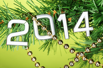 2014 hang on Christmas tree close-up on green background