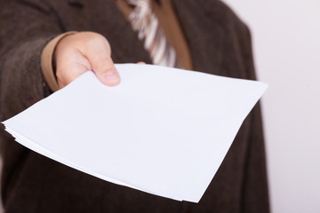 Businessman holding blank sheet of paper. Business concept.