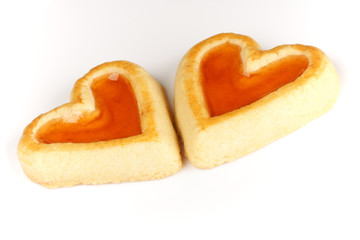 Two heart shaped apricot jam biscuits