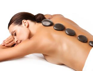 Fototapete - Stone Massage. Beautiful Woman Getting Spa Hot Stones Massage