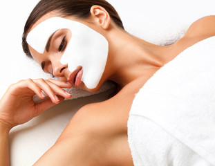 Wall Mural - Beautiful Woman Getting Spa Treatment. Cosmetic Mask on Face.
