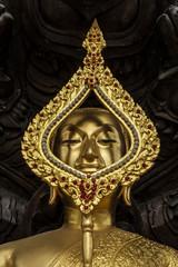 Seated buddha image protected by the seven-headed naga, closed u