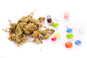 marihuana and pills isolated on white background