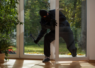 Burglar entering through the balcony window