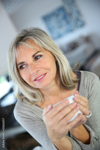 50 Year Old Woman At Home Drinking Tea Stock Photo And Royalty Free