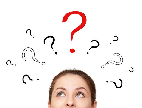Thinking woman looking up on many question signs above
