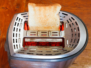 one toasted slice of bread on hot metal toaster
