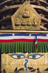 Buddha eyes and Pancha buddha sculpture in to of buddhist stuppa