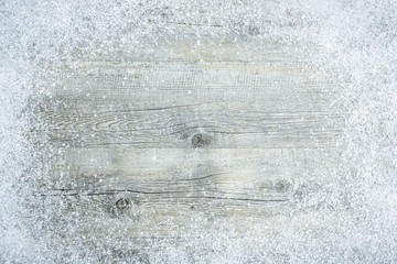 Old wooden board with snowflakes. Christmas background