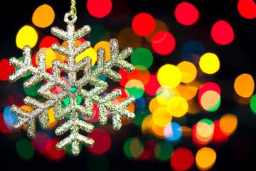 Christmas decoration snowflake  on defocused lights background
