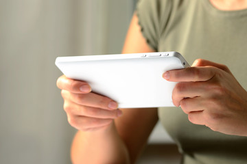 Hands of a man using a PC tablet, from low angle