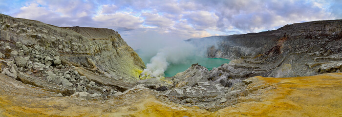 Sulphatic lake in a crater of volcano Ijen. Java. Indonesia. Pan