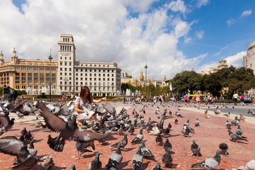 Doves at Catalonia Square in sunny day